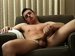 Sexy beam sits fully naked on transmitted to couch and feeds his desire be required of masturbation