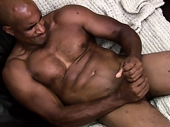 Hung ebony muscleman working hard to rub a load of jism out of his hindrance