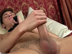 Twink wears only a tie as he strokes his cock