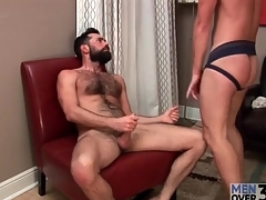 Hottie in jockstrap sucks bear cock