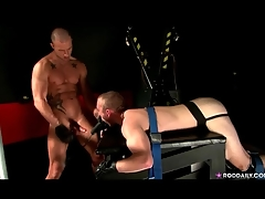 Bound guy sucks dig up in a dark room