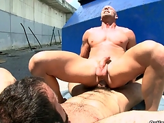 A man with beard fucking his bald boyfriend in the mouth and ass.