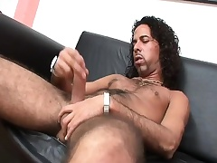 Hairy hunk Mark strokes his long prick until it bursts with pleasure