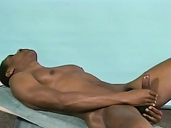 Athletic black stud Michael puts his body on display and masturbates